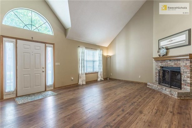 Check out the new laminate flooring here and in the dining room and hall. (photo 3)