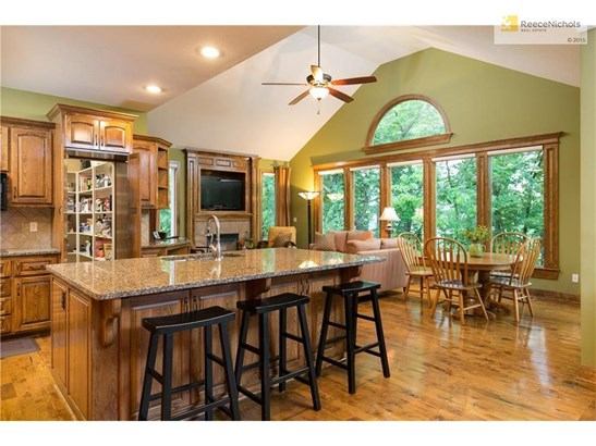 Great kitchen island and as you can see this is one opening to the huge pantry, the other door opens from mudroom/garage area. (photo 3)