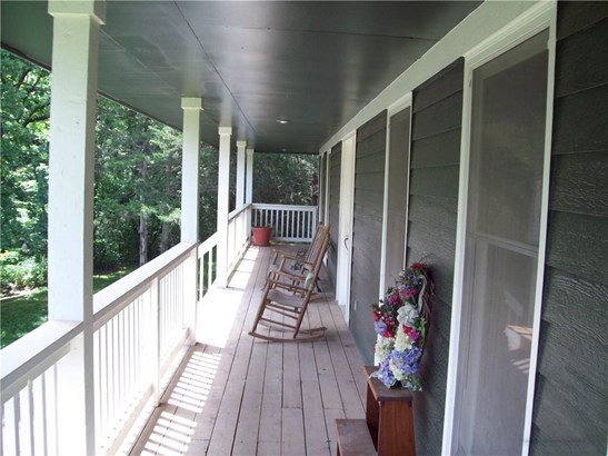 View of covered porch, front and 2 sides (photo 4)