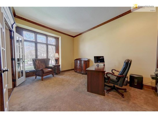 Den/office off the foyer with built ins (photo 5)