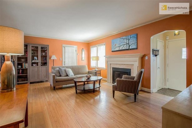 Exceptional and large 20 x 12 living room highlighted by cozy fireplace. (photo 3)