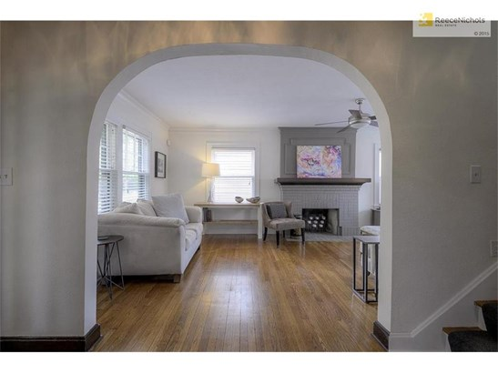 WALK THROUGH THE ARCHED ENTRY into the SUN-FILLED LIVING ROOM! (photo 4)