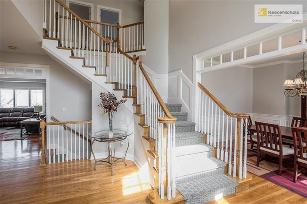 GRAND 2 STORY ENTRY FEATURING DRAMATIC STAIRCASE (photo 2)