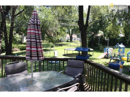 Large, fenced, flat backyard for pets or children to play or quiet evenings on your lard deck. (photo 2)