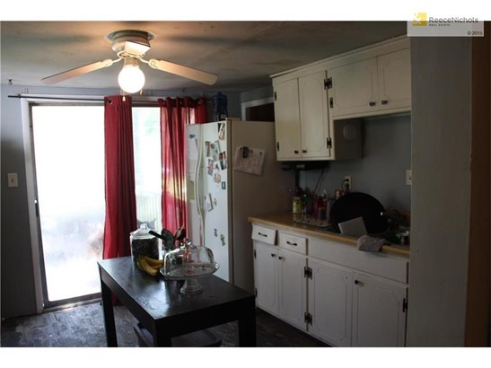 Large kitchen with plenty of cabinets and prep area. Leads out to large deck and backyard (photo 4)