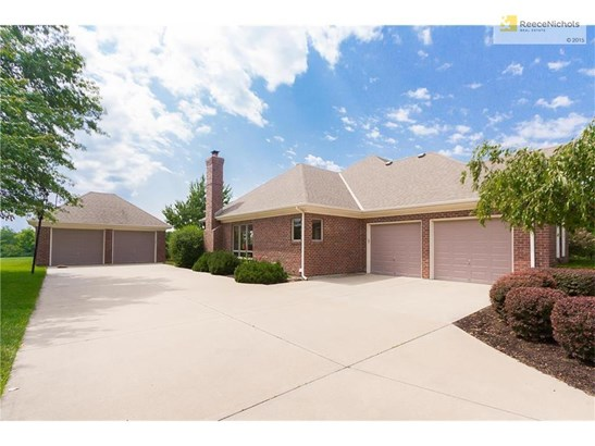 All brick ranch home has side entry garage plus separate 2-car heated garage. (photo 2)