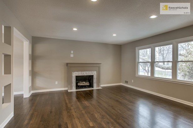 Wow!! Check out these refinished hardwood floors and todays interior colors. Beautiful tile around fireplace. (photo 2)