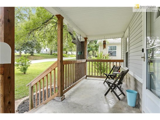 Enjoy the beautiful fall colors and weather out on the large, inviting front porch. (photo 3)