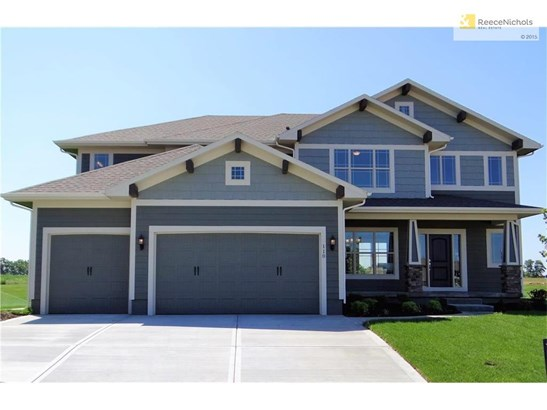 Welcome to 110 SE Shores Court in The Shores at Chapman Farms. This Bristol Ridge II plan has 5 bedrooms, 4 bathrooms and a sitting room in the Master Suite with a fireplace. (photo 1)