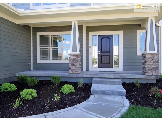 Beautiful landscaping leading to front entry and front porch. (photo 2)