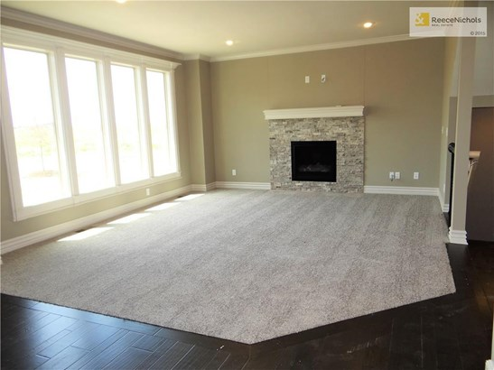 Great room has floor to ceiling windows allowing for natural light, gas fireplace and pre-wired for surround sound. (photo 5)