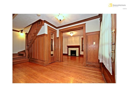 Front Entry has beautiful woodwork and is located right between the living room and the family room. (photo 4)