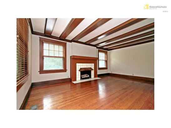 Living Room has beautiful beamed ceilings and a gas log fireplace. (photo 5)