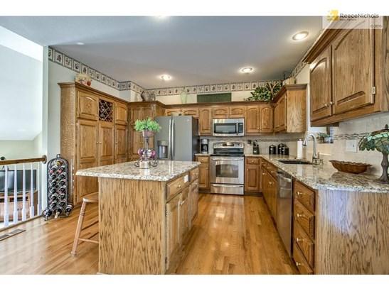 WOW! what a kitchen, granite counters, title backsplah (photo 2)