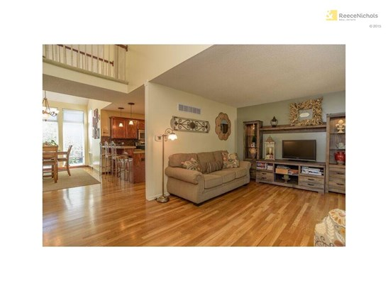 Living room, Kitchen and Dining room with wood floors! (photo 4)