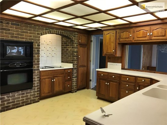 Custom Kitchen newer counter tops, custom cabinets and brick recycled from the KC stockyards (photo 4)