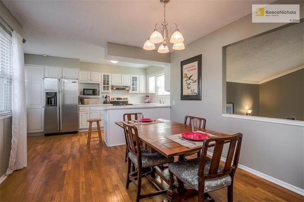 Spacious dining area with beautiful hardwood floors and brushed nickel light fixture. (photo 2)