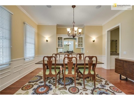 Formal dining room with built-in china cabinet and granite serving space (photo 2)