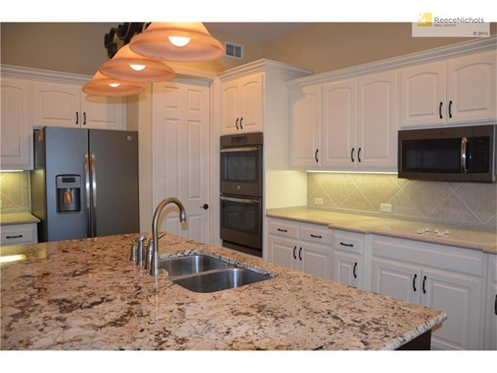 Large kitchen offers plenty of cabinets, granite counters, and brand new slate GE appliances. The center island is perfect for entertaining (photo 5)