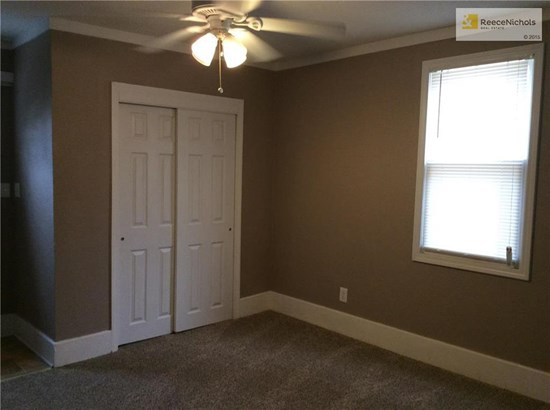 Master bedroom is in converted garage area or this could be a family/TV room. (photo 5)