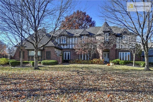 Absolutely Breathtaking Curb Appeal with Mature Landscaping and Tudor Style Exterior. (photo 1)