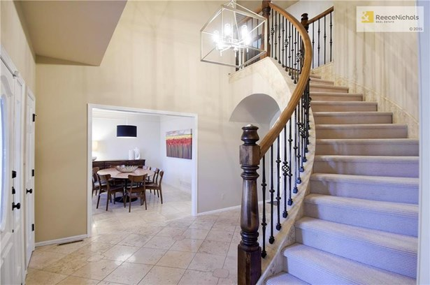 Modern Light Fixture and Access to Dining Room off the Entry. (photo 4)