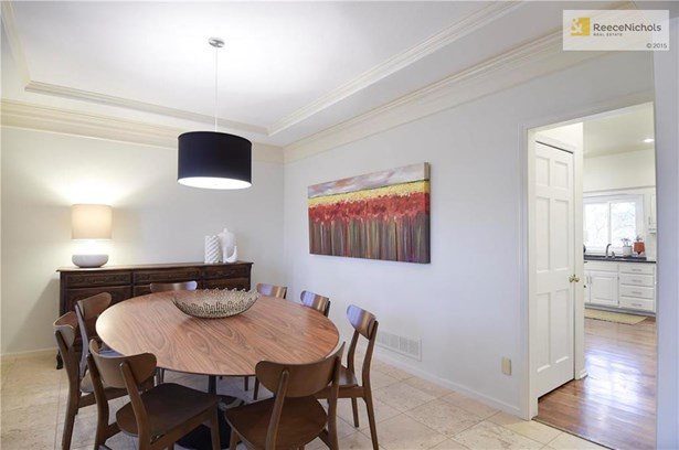 Sleek and Modern Dining Room off Entry with Direct Access to the Kitchen. (photo 5)