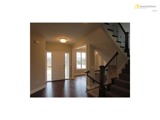 Entryway beckons with natural light streaming through sidelights! (photo 2)