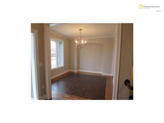 Hardwood dining or office -- large windows, chandelier and light wood edging sets off the beauty of the main floor (photo 3)