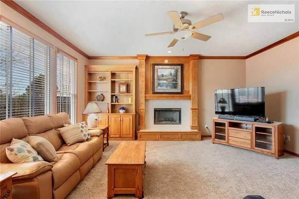 Family Room.  Built-In cabinets; fireplace; new carpet in 2018 (photo 1)