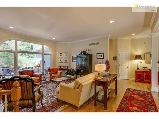 Great Room with floor to ceiling windows (photo 5)