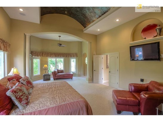 Enjoy the views of heavy woods and Falcon Ridge golf course from this tiled lanai! (photo 3)