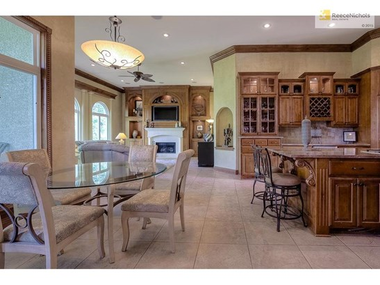 Gourmet kitchen with miles of cabinetry, huge island and stainless steel appliances! (photo 4)