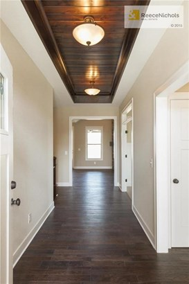View as you step into foyer.   2nd bedroom with bath to right, and office across from stairs to lower level. (photo 4)