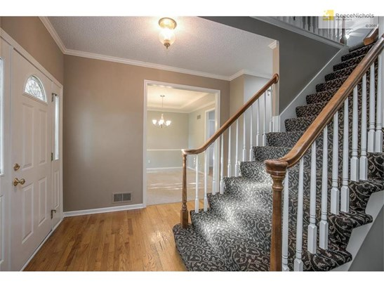 Once in side you will find beautiful hardwood floors, timeless designer stair carpet, new carpet and paint in every room. (photo 3)
