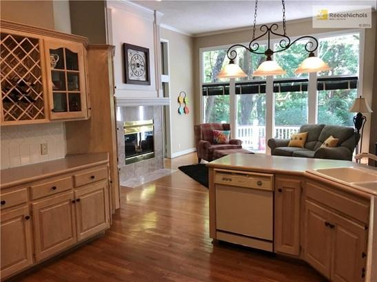 Kitchen is open to hearthroom ad breakfast room. Windows overlook the pool (photo 3)