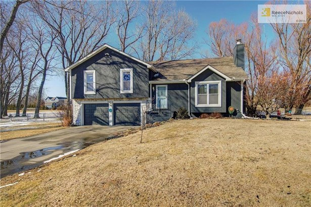 Gorgeous and freshly updated Front/Back Split on 1.0 Acre Lot with fence!  Take a look at those views and imagine the sunsets/sunrises that you would be able to see!! (photo 1)