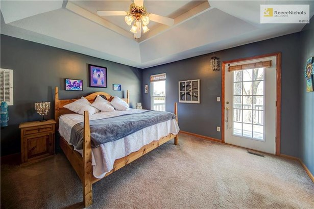 Master Bedroom with vaulted ceilings, ceiling fan, his and her's walk-in closets, newer interior paint, access door to the deck, and views to die for! (photo 5)
