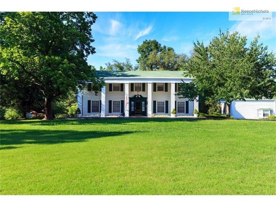 Front elevation of this Plantation style home which initially started as a mid 1800's cabin. (photo 1)