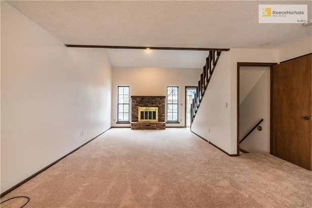 Lovely fireplace in living room and dining room! (photo 5)