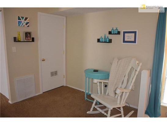 Great room, opposite side of fireplace - note the door to the utility closet (photo 5)
