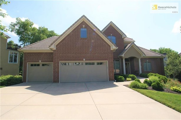 Welcome home! Beautiful brick exterior with covered entry, brand new garage doors, and extensive landscaping. (photo 1)