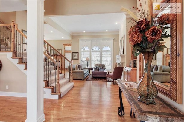 Breathtaking foyer opens up to the split staircase, dining room on left, and formal living room ahead. (photo 2)