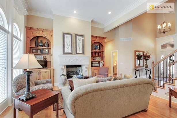 Beautiful built-ins flank the fireplace in the formal living space (photo 5)