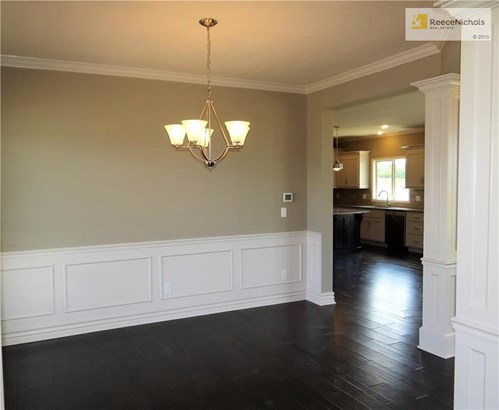 Dining room with gleaming hard wood floors. (photo 3)