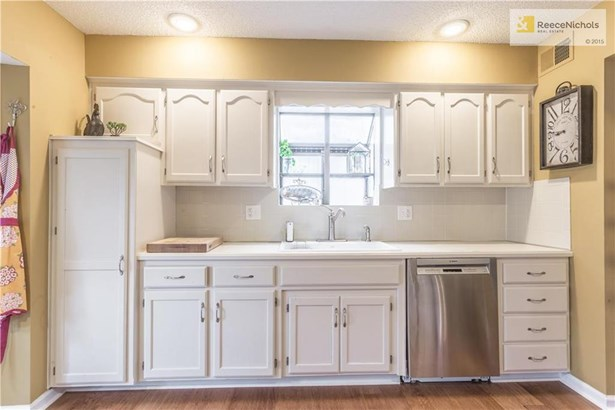 Mini bay window over kitchen sink with shelving!  Large white farmhouse sink. (photo 4)