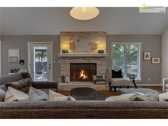 Stacked stone fireplace, vaulted ceilings, wonderful views of backyard! (photo 5)