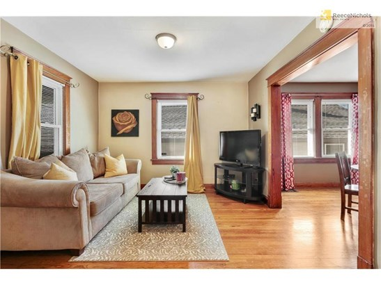 The living room gets great natural light and is open to the formal dining room (photo 4)