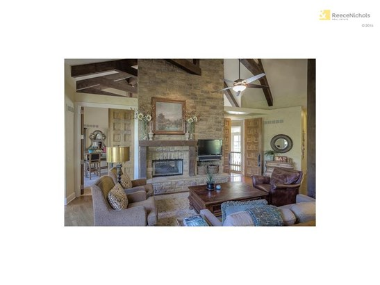 Floor to ceiling Canyon Stone fireplace beamed ceiling and hardwood floor. (photo 5)