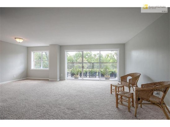 The spacious living and dining rooms have new carpet, updated light fixture and wonderful molding around the windows and doors. (photo 2)